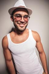 fashion man posing against a white wall