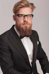 young elegant business man wearing a tuxedo