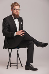 blonde business man sitting on a stool