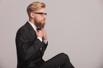 elegant business man fixing his bowtie