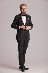 elegant business man standing on grey studio backgroud
