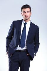 Handsome elegant business man looking up