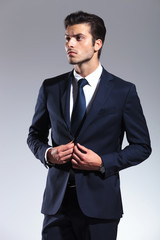 Attractive young business man looking up