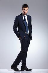 elegant business man holding hands in pockets