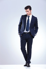 young elegant business man looking down