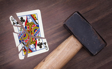Hammer with a broken card, queen of clubs