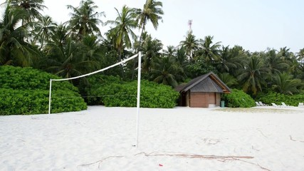 Torn beach volleyball net at tropical beach