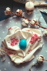 Easter decoration - wooden egg on fabric napkins, with cotton br
