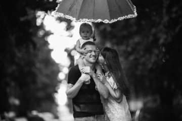 Happy family under the rain