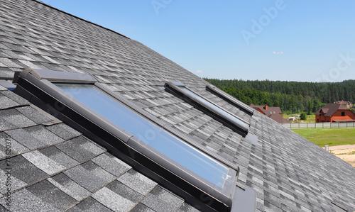 Leinwandbild Motiv Roof windows and skylights and blue sky