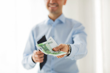 close up of businessman hands holding money