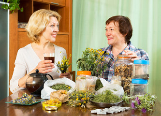 woman drinking tea with her neighbor