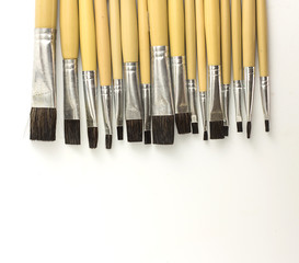 Paint brushes arrange  on white