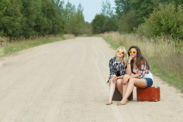 Student girls wearing sunglasses on country road