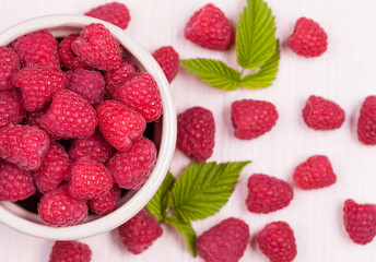 Raspberry superfood in a bowl on a white background