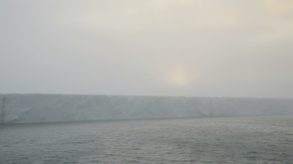 Sunrise on a glacier reaching the sea 4