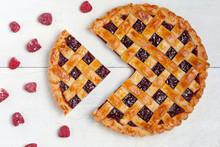 "Постер, картина, фотообои ""Sliced raspberry pie with fresh raspberries on white table"""