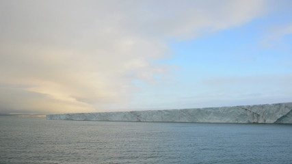 Ice cliff of a glacier reaching the sea