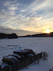 Snow Covered Lake At Sunset