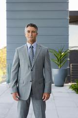Businessman standing on a terrace