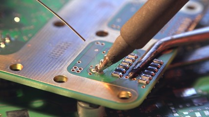 Soldering on a PCB (4K UHD detailed macro footage)