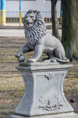 Monument of stone lion on a pedestal in Lviv