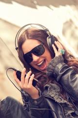 Urban girl listening to some music.