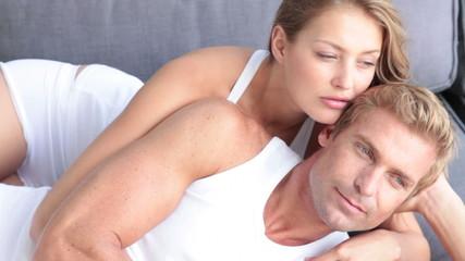 Young couple embracing on sofa