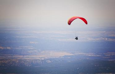 Paraglider flying over El Escorial
