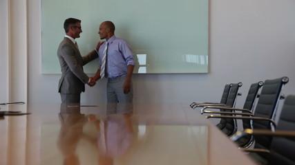Handshake in meeting room