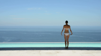 Woman walking by the pool