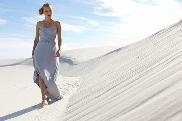 Woman walking on the dunes