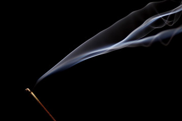 Burning incense on black background