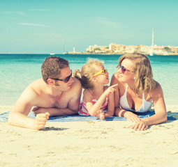 Happy family on the beach vacation.