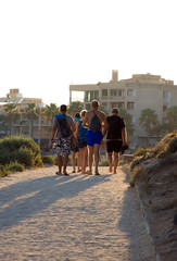Group of people going from the beach.