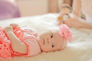 Little baby girl wearing pink knitting dress