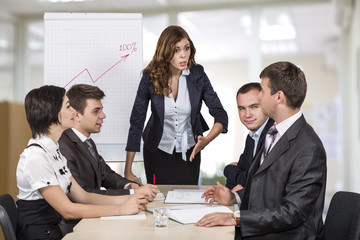Energetic corporate manager instructs her team