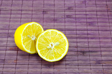 Halved lemons on a bamboo surface