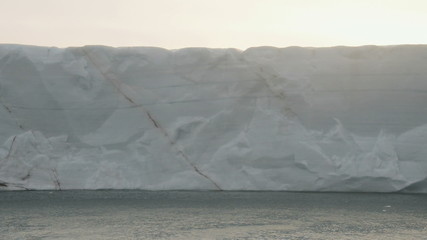 Ice cliff of a glacier reaching the sea 2