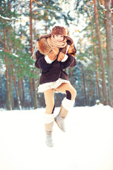 Winter enjoyment.Cheerful girl having fun in forest.