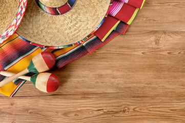 Mexican sombreros and blankets on pine wood floor