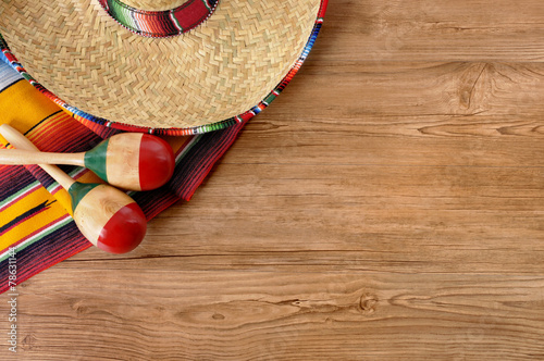 Fotobehang Mexico Mexican sombrero and blanket on pine wood floor