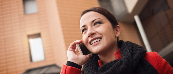 Smiling woman having a phone call