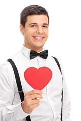 Elegant man holding a heart shaped cardboard