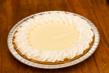 Whole Lemon Meringue Pie on Wood Table