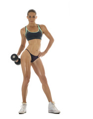 Athletic girl with dumbbells on a white background