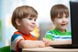 happy children playing at laptop