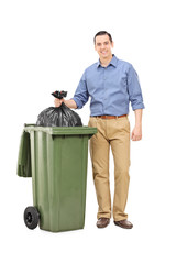 Full length portrait of a man throwing out garbage