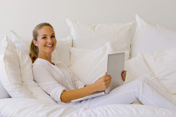 Young woman  surfing the net on sofa
