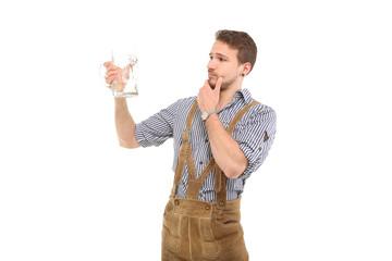Mann in Tracht mit Maßkrug